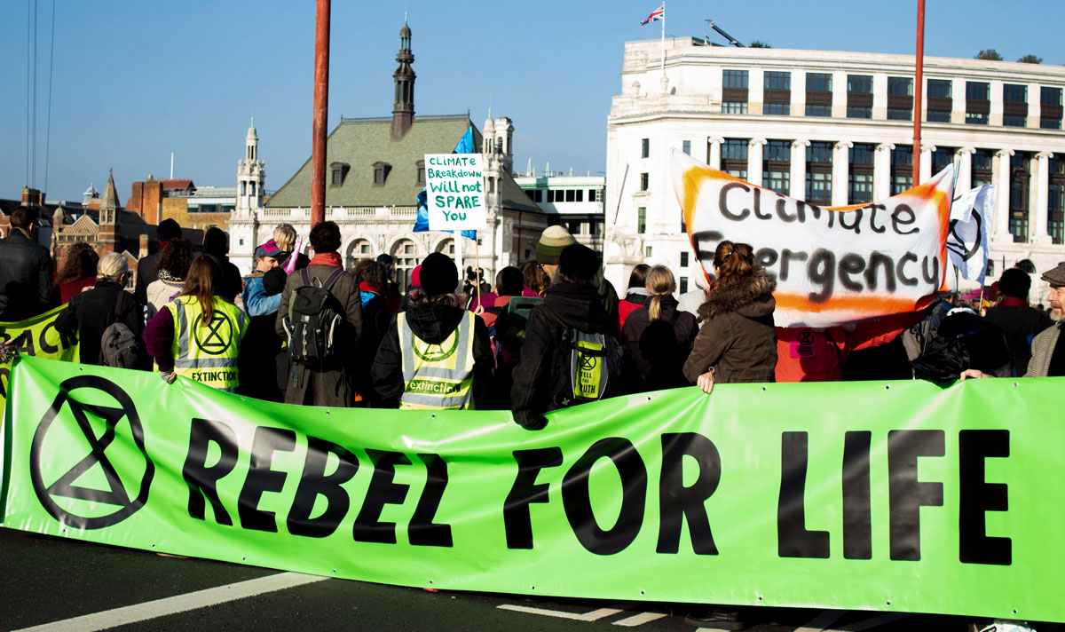 Extinction Rebellion protesters with Rebel For Life Banner in Street