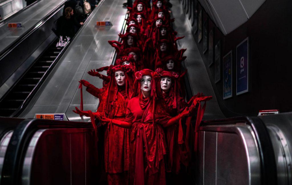 XR Extinction Actors on Escalator